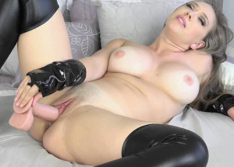 Kagney fucks her twat with a big dildo